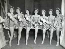 High-kicking chorus line of costumed Junior Leaguers perform in the Junior League Follies of 1964.